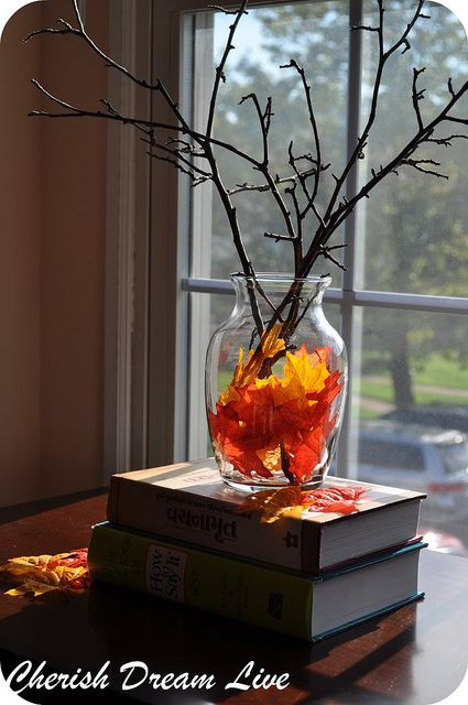 Today the kids and I collected lots of beautiful Autumn leaves. I added them to my large vase when I got home, I dont plan on adding sticks. The leaves make a beautiful centerpiece on our table.