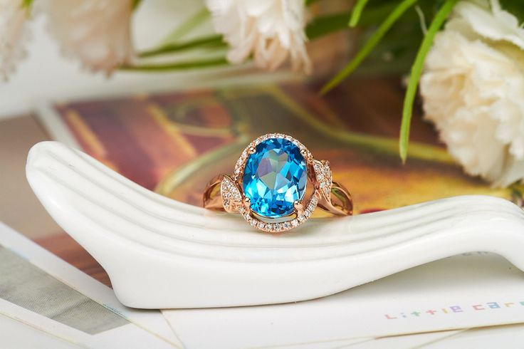 This perfect designed topaz ring has been crafted to perfection. Made with real gold 14, main stone with topaz, real stone with real diamonds. All of our items can be modified to fit different sizes stone according to your requirements!
