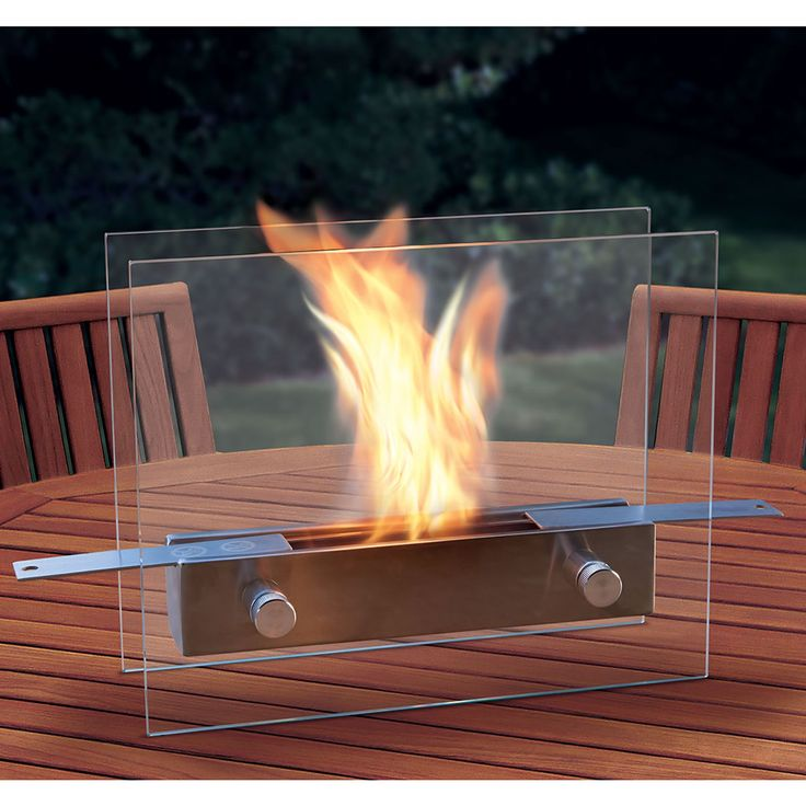The Tabletop Fireplace - This is the liquid fuel fireplace that rests on any stable surface and provides the color, crackle, and comfort of a wood-burning fire without smoke, smells, or sparks.