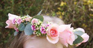 Dainty flower-girl's floral crown of pink roses and eucalyptus. Florissimo, Shropshire