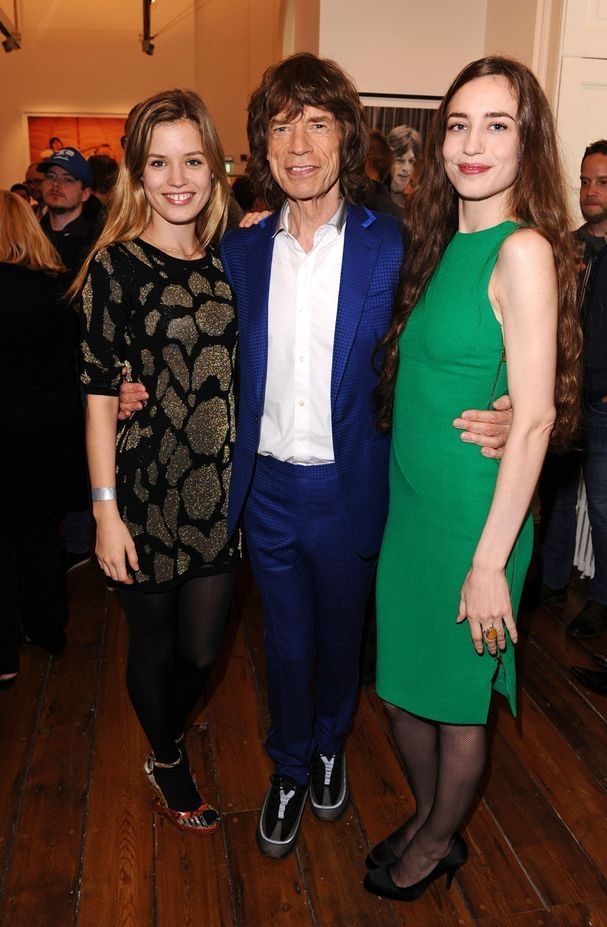 Mick Jagger wuth his youngest daughters Georgia and Lizzie Jagger.