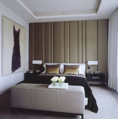 Penthouse Guest Bedroom with custom-designed upholstered wall and bedside tables. by Patrick Tyberghein / CarterTyberghein