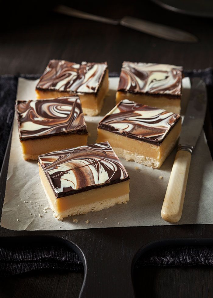 Chocolate caramel slice recipe with a thick layer of caramel on a crunchy base and covered in chocolate.
