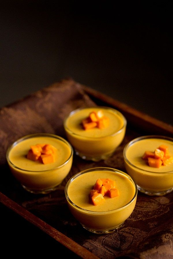 mango panna cotta recipewith step by step photos - smooth velvety vegetarian panna cotta made with mangoes.    this famous italian dessert is hubby's favorite dessert and i do make them occasionally. when the season of mangoes