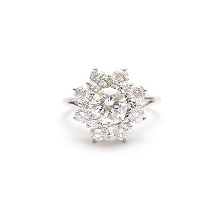 Vintage 1950s starburst engagement ring featuring a 1.16 carat diamond. Center stone is surrounded with 1.12 carats of accent diamonds; 2.28 CTtw. A stunning mid-century treasure.