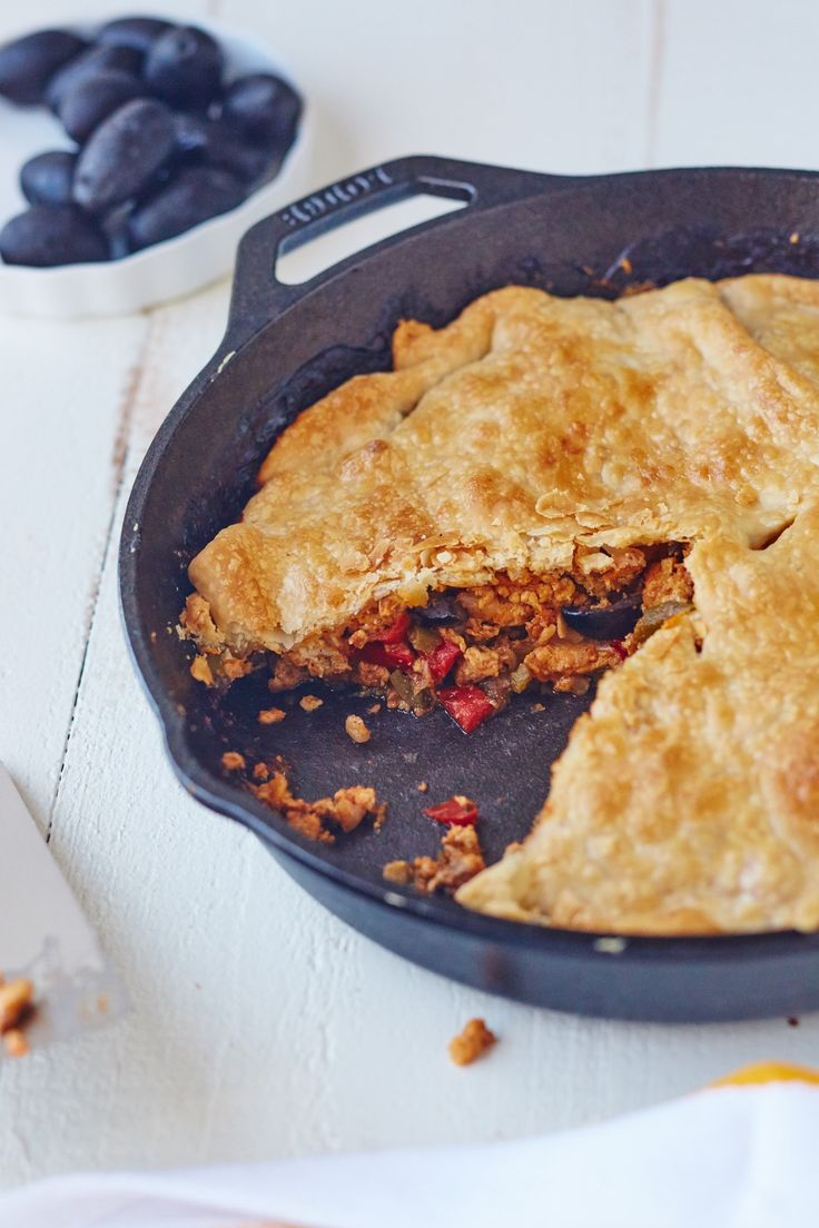 This quick weeknight version reimagines empanadas into a skillet pie, with a bubbling layer of juicy ground chicken topped with flaky pie crust.