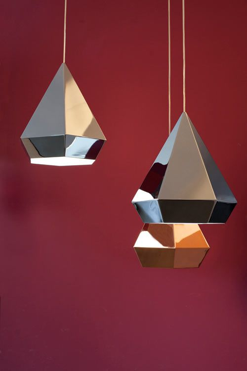 Diamond pendant lights by Sebastian Scherer. Each has twelve facets and multiple reflexions. Available in chrome, copper, white and black. They seem to vary in size depending upon the angle from which they are viewed.