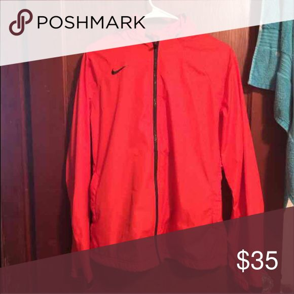 Women's Nike Rain Jacket Light weight zip up. Worn a few times. In great condition. No rips, tears, cuts, etc. Color is orange not reddish orange like the photo looks Nike Jackets & Coats Utility Jackets