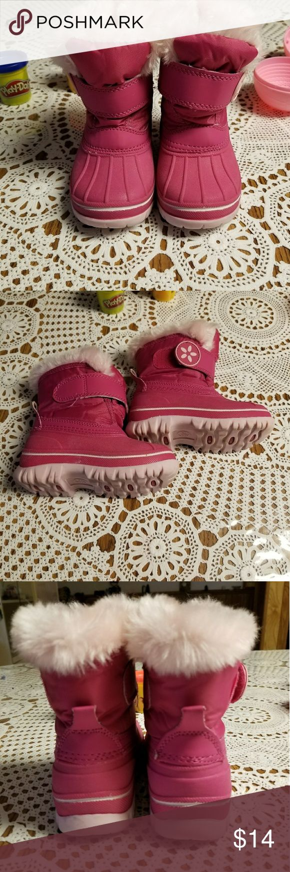 Kids snow boots Textured sole gives her traction.  Velcro closure.  Faux fur. So Soft inside.  She only got to use them once last year and this year they don't fit her.  You can even write on the inside who the shoe belongs to. Size 5/6. Small Shoes Rain & Snow Boots