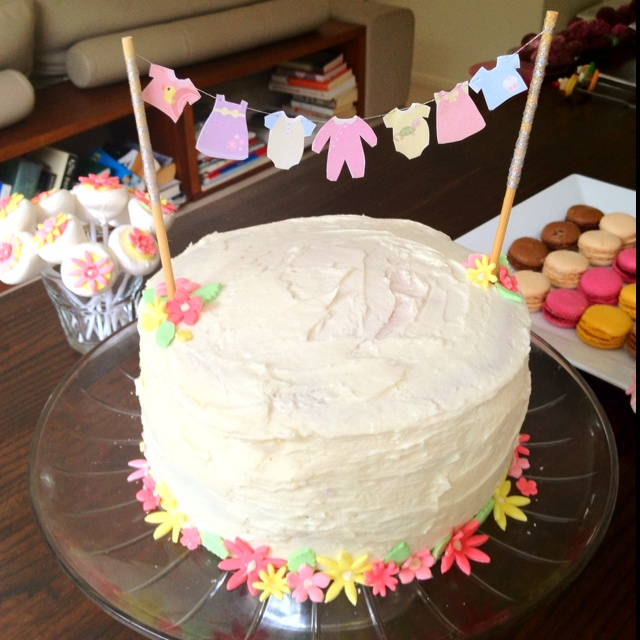 While this topper is a clothesline on a layer cake, it would easily be a message or other design, and could go on a sheet cake as easily.  I think little kid on a swing could be cute.