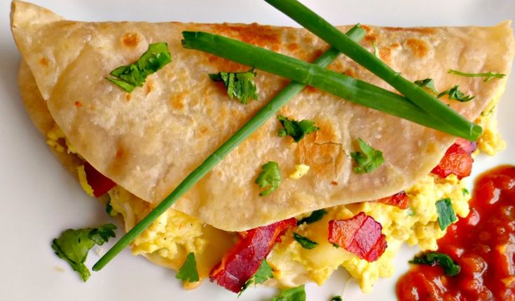 Sunrise Quesadillas - an easy Mexican inspired recipe with bacon and eggs. Delicious and easy to make!