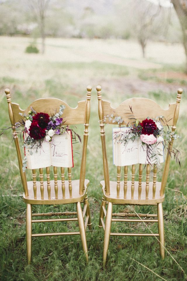 Book chair decor | Bellamint Photography and Sunflower Creative | see more on: http://burnettsboards.com/2014/09/literary-wedding-book-page-wedding-dress/