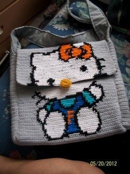 Hello Kitty Bag in tapestry crochet. Straps are crocheted long and sewn onto the front and back of the bag creating the sides. Hello, Kitty!  I can do this! ¯\_(ツ)_/¯