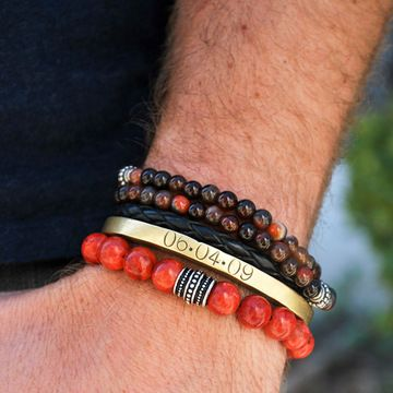 Stacked red men's bracelets