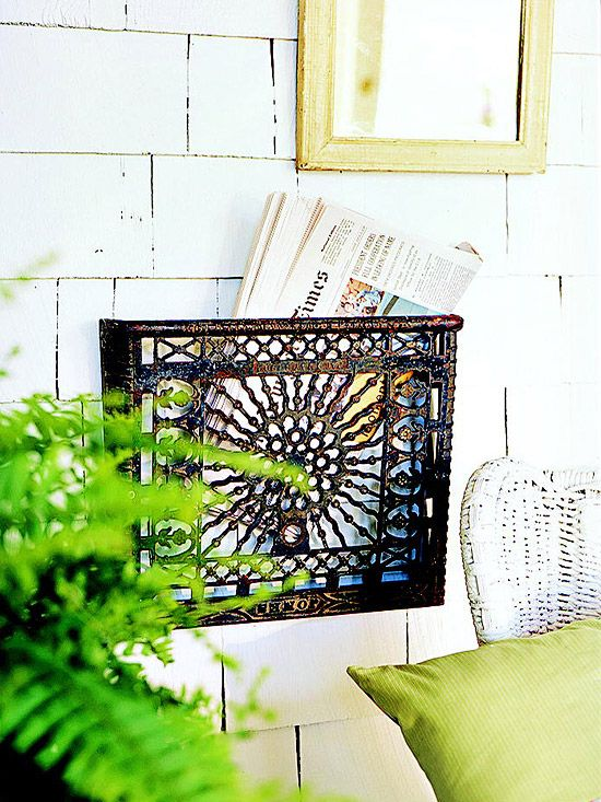 Salvaged Mail Rack from Heat Grate  What it is: An old metal heating grate is repurposed as a newspaper and mail rack.        How to make it: Clean the metal heating grate by scraping away flaking paint with a wire brush and washing with a mixture of equal parts warm water and vinegar. Screw to the wall after cleaning.