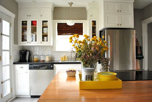 white cabinets grey walls with yellow accents: Yellow Flowers, Kitchens Subway Tile, Rockport Gray, Kitchens Counter, White Gray Kitchens, White Subway Tile, Yellow Accent, Gray Yellow, White Kitchens