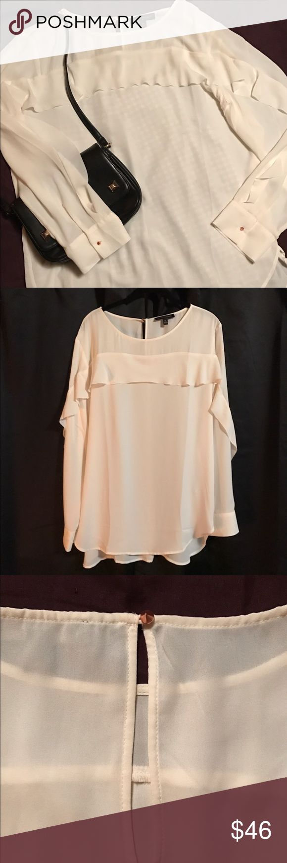 "Romantic, elegant blouse NWOT Creamy white long sleeved blouse with a single loose ruffle that extends from wrist, up arm, across upper chest, down opposite arm, ending at wrist.  Shirt tail hem measures 26"" front neck to hem and 30"" back neck to hem. Cuffed wrists and back neck close with rose gold rounded pyramid shaped buttons.  Stunning with a pencil skirt or skinny pants.  100% polyester, machine washable. Banana Republic Tops Blouses"