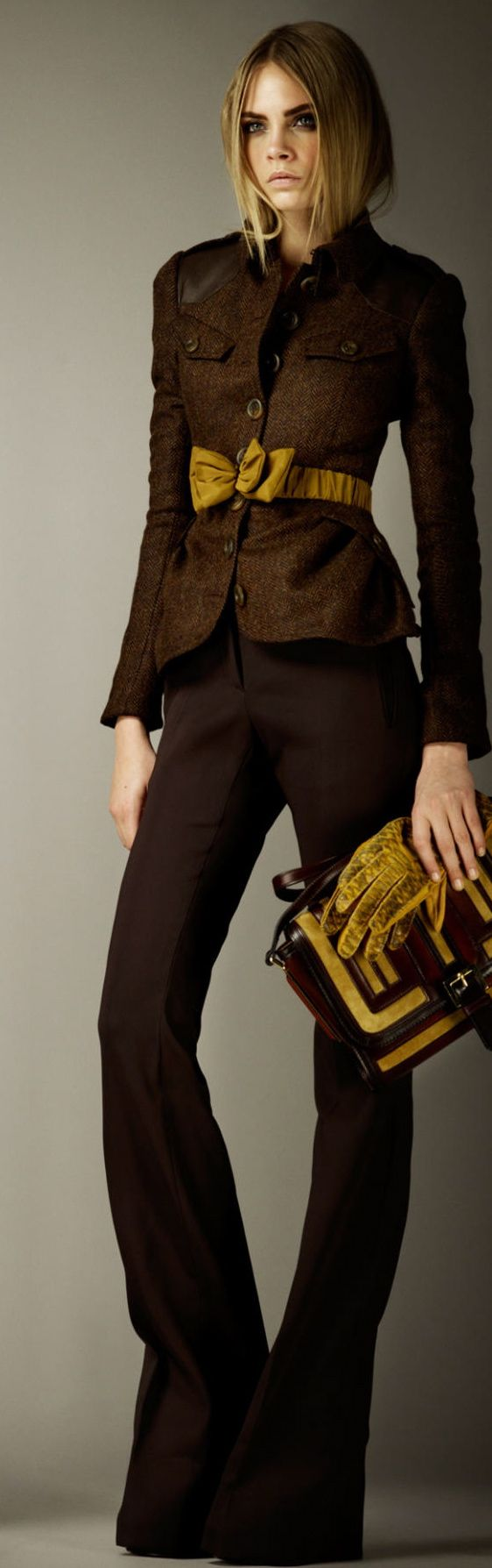 Burberry. Like the suit, would not tie the belt in a bow either be buckled or tie with artistic knot.