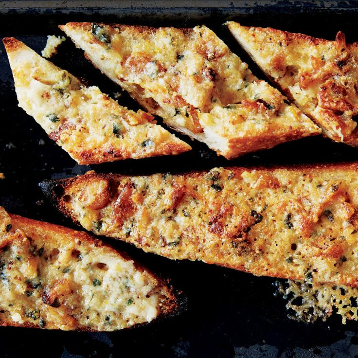 Lush confited garlic takes toasty, cheesy baguettes to another level.