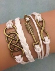 """Opt for elegance in white and gold with this infinity and arrow design. Clean aesthetic that is great for all of your wardrobe selections when looking to add a little something extra. - Size: 6"""" long"""