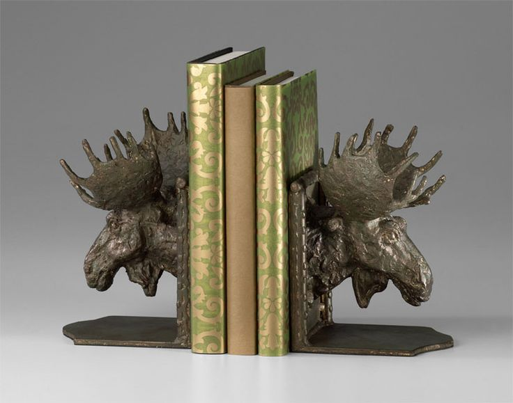 Moose Head Bookends: whimsical and masculine. Perfect for holding his favorite literature, these bookends are finely crafted of  heavy iron in a bronze finish. These masculine sculptures are an excellent choice for adding texture and animation to a desktop or bookshelf. The Moose Head Bookends are an excellent gift for the wild game sportsman, or for your own handsome tabletop decor. $207.50