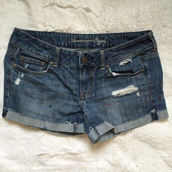 American Eagle Distressed Paint Shorts {RESERVED} Jean shorts with tears and some paint details. Cuffed once but could be rolled again! American Eagle Outfitters Shorts