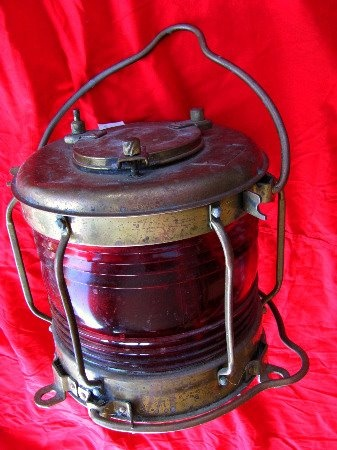 """This authentic red, round electric lamp is typically used as a """"Not Under Command"""" light, where two are used one over the other at night when the ship has lost power or control. For sale at http://on.fb.me/LWFRDM"""