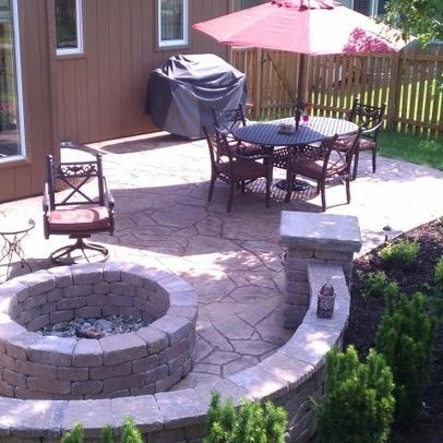 Traditional Stamped Concrete Patios With Conventional Round Rock Fire Pit  Also Cool Outdoor Dining Furniture With Red Umbrella Also Brown Wooden Wall  ...