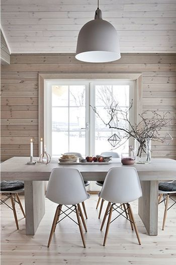 Everything about this is my favorite. I love the floors and walls, the heavy set dining table, and the simple, Eames side chairs.