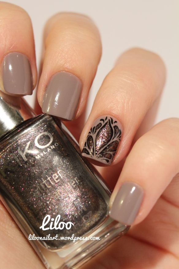 Gorgeous taupe model nail art with black freehand design by Liloo - all of her designs are amazing...x