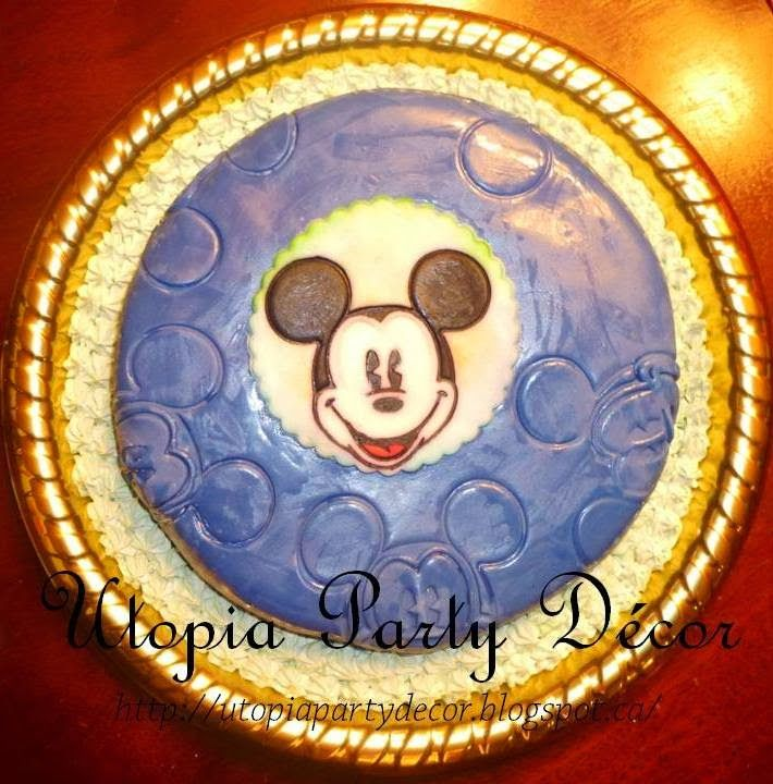 Hand painted Mickey Mouse cake with textured fondant