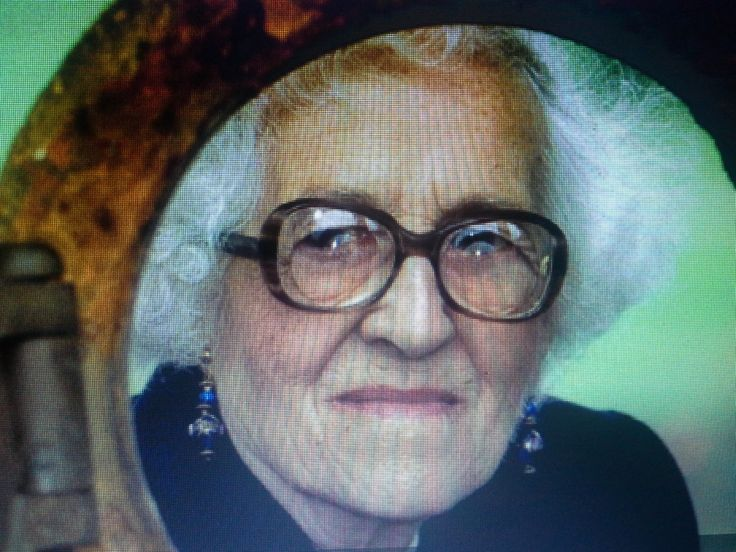 Millvina Dean---1912--2009---She is looking through an original Titanic porthole.  She was only a few months old when she boarded the Titanic with her family.  She was the youngest survivor of the wreck.   Photographed in 1994---