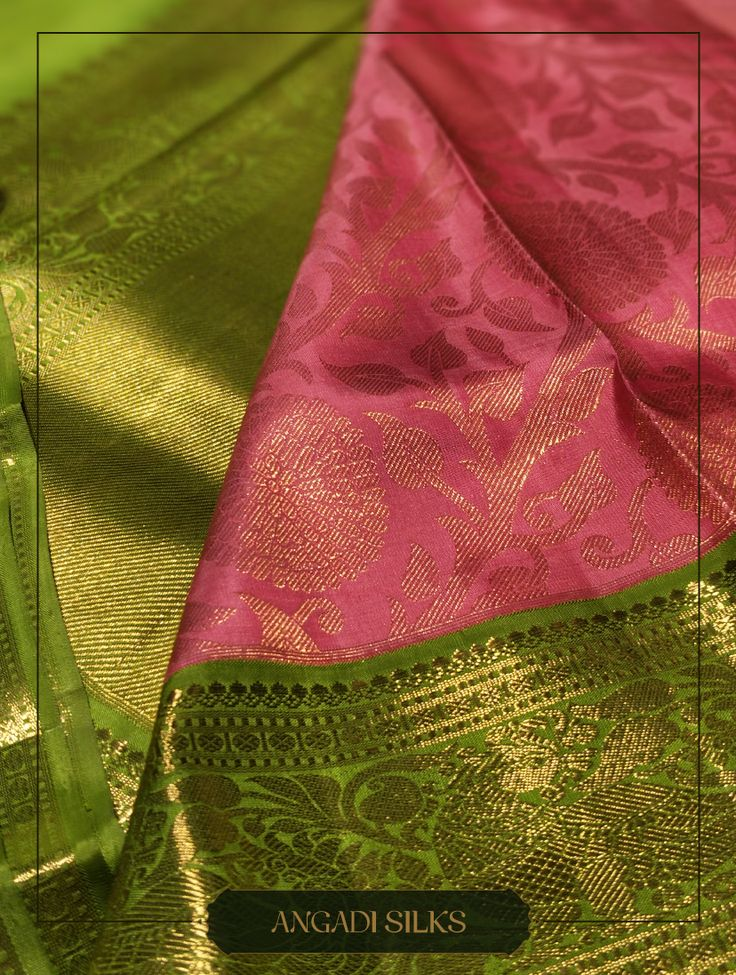 Pink and Green, brocade gold zari saree from Angadi Silks. The Motif showcases M... 12