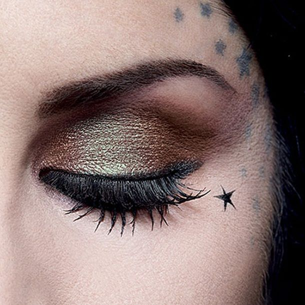 I love Kat Von D's stars! I wish I could do that.. < i don't think i could pull off a facial tattoo.... body bling, yeah, but face ink.... eh.