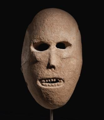 9,000-year-old limestone mask from the Judean desert, among the earliest sculptural types to survive from the ancient Near East.