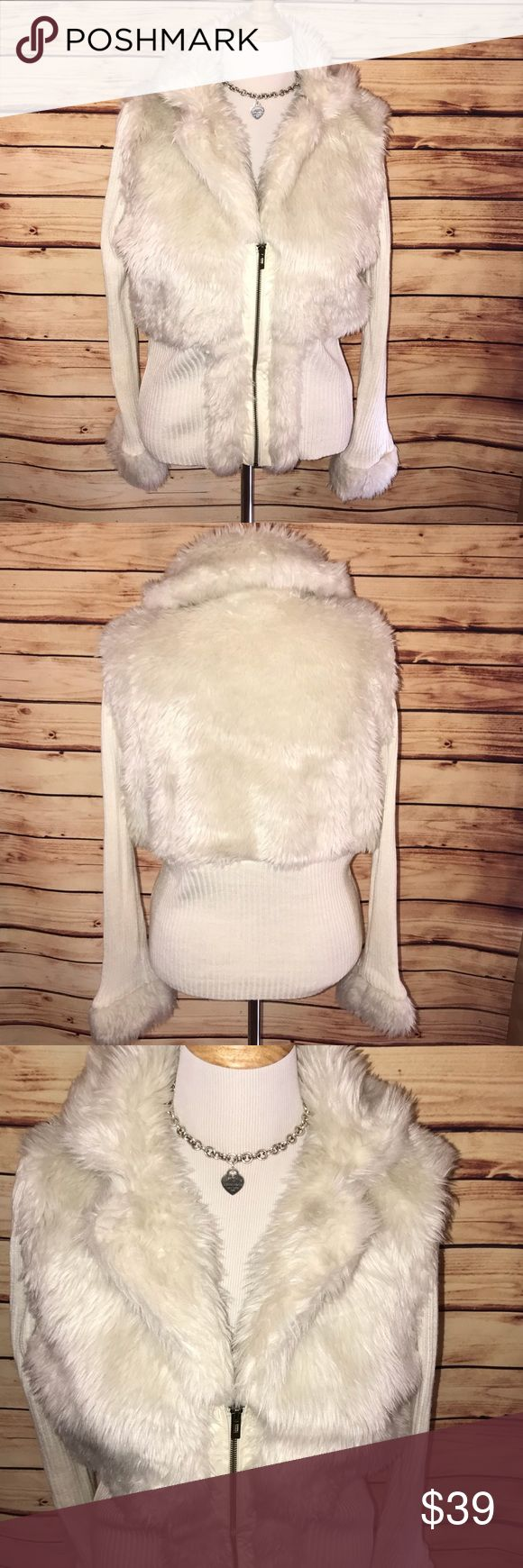 🆕 Roz & Ali Faux Fur Zip Up Sweater Coat Gorgeous furry and plush sweater coat. Super soft and stylish, beautiful neutral cream shade-definite head turner. BNWT from Dress Barn, no flaws. Excellent quality and condition. Check out my other listings to bundle and save! Roz & Ali Jackets & Coats