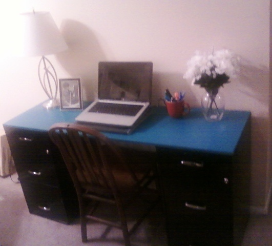 Two File Cabinets From Walmart With A Piece Of Scrap Wood From Home Depot  Painted Teal And Placed Over The Top.