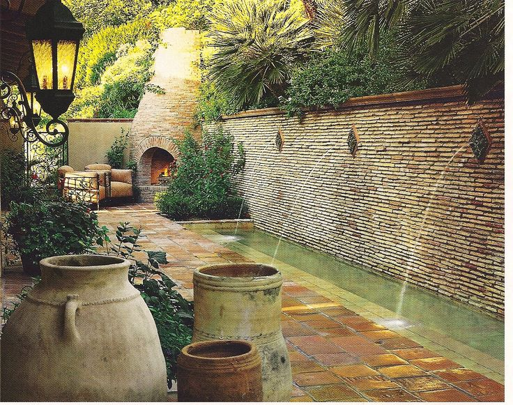 a little to tuscan for me but love the idea of a small wading pool in leu of a giant (expensive) regular pool