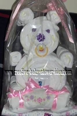 Learn how to make a diaper bear to give as a fun baby gift for an upcoming baby shower! Use diapers to create your own diaper bear craft.