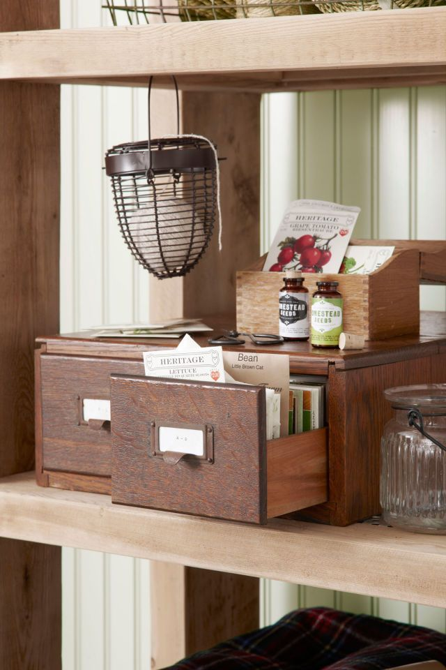 A second-hand card catalog easily doubles as a brilliant filing system for seed packets. Want extra room? A recipe box will fit the bill, too.   - CountryLiving.com