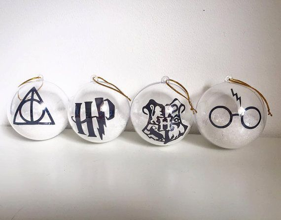 These personalised Christmas tree decorations are pretty and unique for Harry Potter Fans.  A clear ball filled with a white snow inside with personalising done in vinyl.  Any questions, please dont hesitate to ask!  ** This is for 1 bauble only **  If you buy the set of 4, please let me know what colours and logos you require in the message to seller section when buying.   ---SHIPPING---  Shipping takes 3-5 days BEFORE posting as all orders are handmade to order by myself. I will keep you…