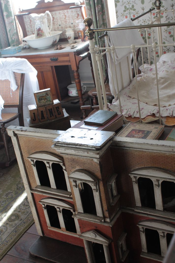 Child's bedroom with dollhouse, 1900s Town, Beamish, County Durham UK