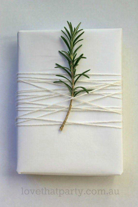 white christmas gift wrap rosemary sprig
