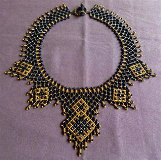 Beautiful necklace, but the link leads to the homepage of a French blog. No pattern to be found....  I can't figure out what's going on at the collar of the necklace. This might be a fun piece to try and replicate after this semester ends.