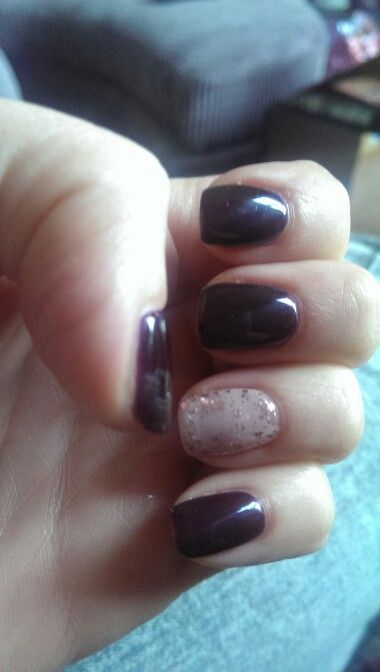 Dark purple nails with a taupe accent with rose gold glitter