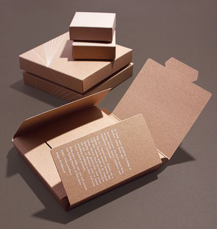 Kraftboard jewellery packaging for Angie Boothroyd with matt white foil-blocked pattern; easy to store, environmentally friendly folded design; understated luxury.