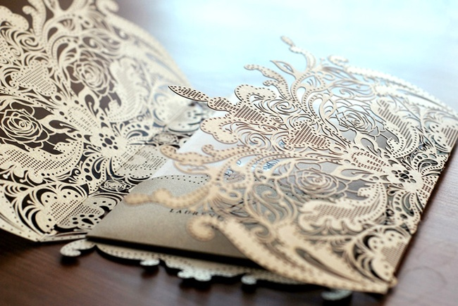 Krista A. Jones-Paper lace- The enclosure that wrapped around the invitation and had a pocket for the rsvp card and directions. The enclosure was lasercut and then folded around the invitation set. The invitation, rsvp card and directions were embossed and printed on luxury paper.