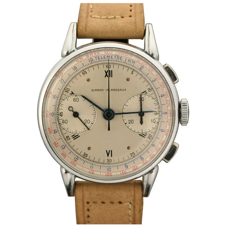 Girard-Perregaux Chronograph  Swiss  1950s  New old stock Girard-Perregaux two register chronograph. It features a beautiful three color dial. This is a truly rare watch in unbelievable condition with its original box and hang tag.