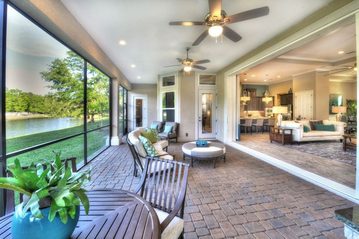 A covered lanai opens wide to this great room. The Egret V plan, a new home by ICI Homes. The Oakmont community. Gainesville, FL.