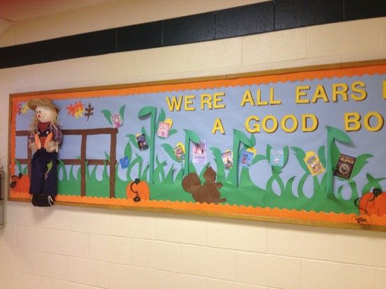 """""""We're all ears for a good book"""" bulletin board for school library and book fair.  Library bulletin board ideas."""